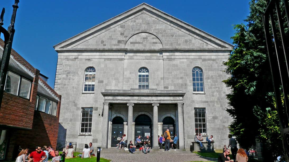 Blue skies and people sitting outside Triskel Christ Church, Co. Cork