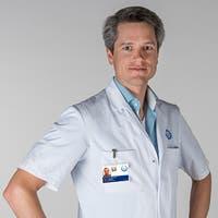Dr.   Leenders