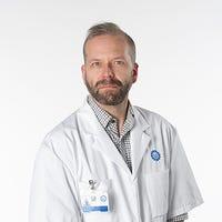 Dr.   de Vos