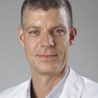 Dr.    Vrancken