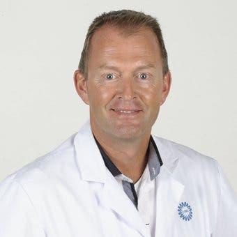 Dr.    Arets