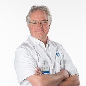 Dr.    Schuurman