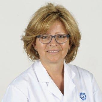 Dr.    Schoenmakers