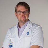 Dr.   Wyndaele