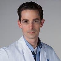 Dr.   Muijs