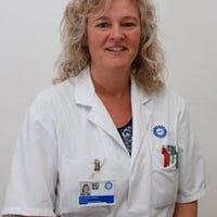 Dr.   Tekstra