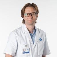 Dr.    Mous