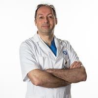 Dr.    Muradin