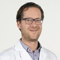 Dr.   de Heus