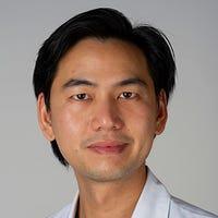 Dr.   Tandjung