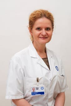 Dr.   Mudrikova