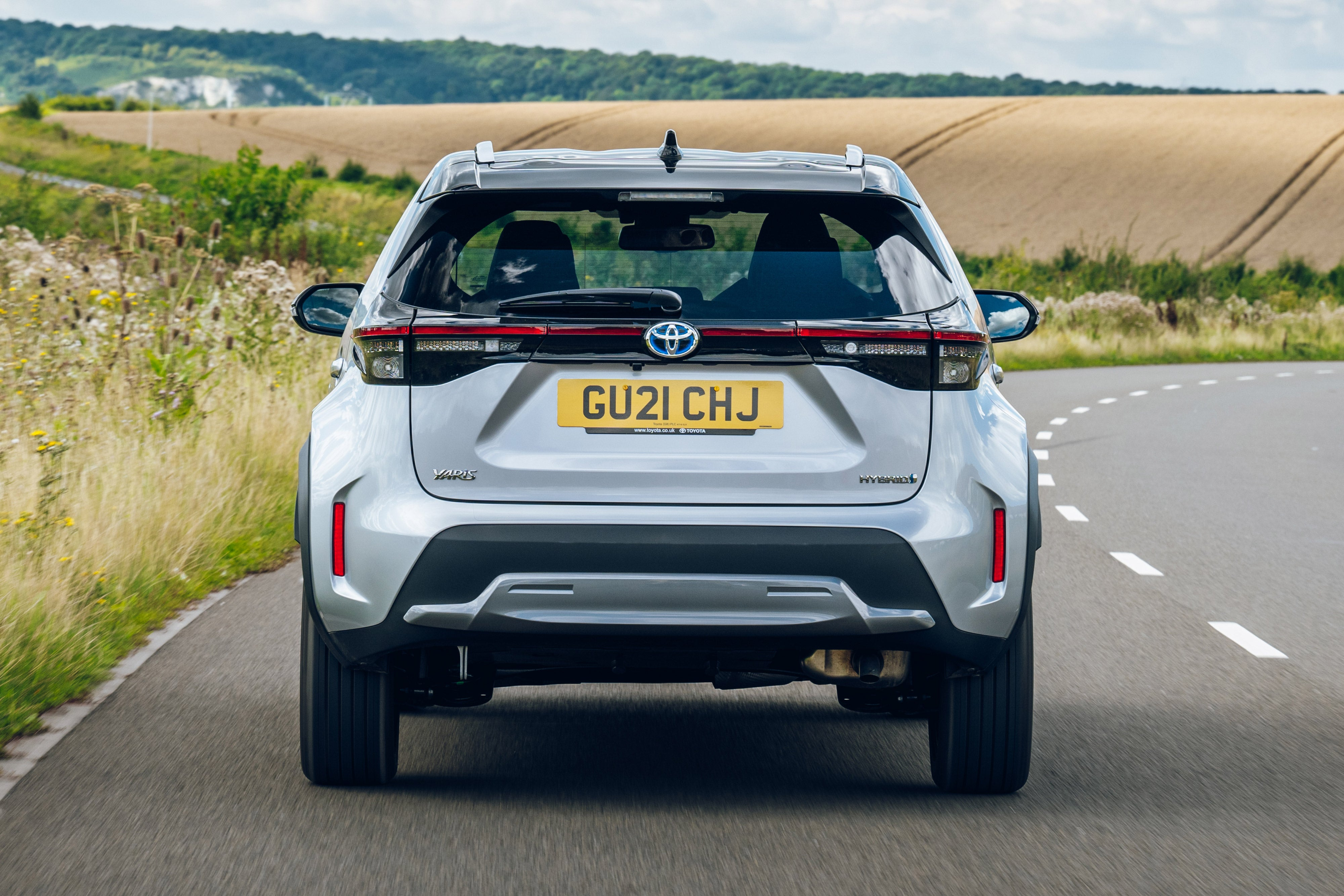 Toyota Yaris Cross Review: silver car rear moving