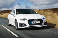 2020 Audi A5 driving front-three quarter