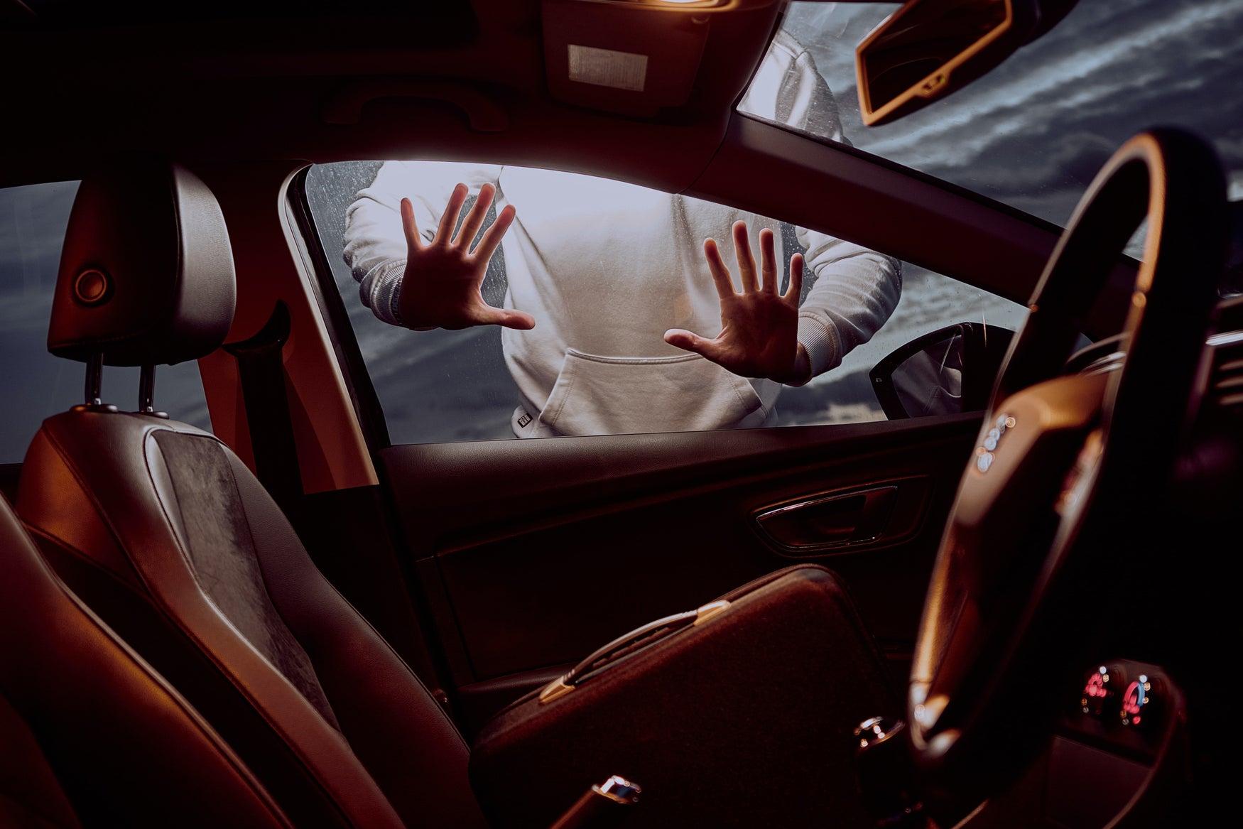 thief looking in car