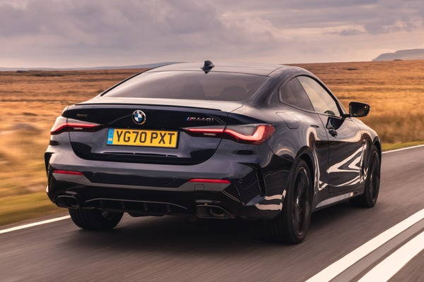 BMW 4 Series exterior driving rear