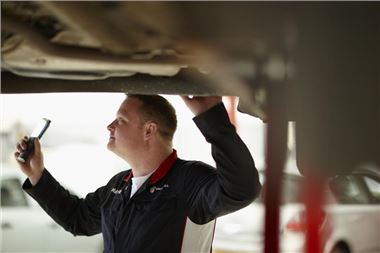 Technician working on a catalytic converter