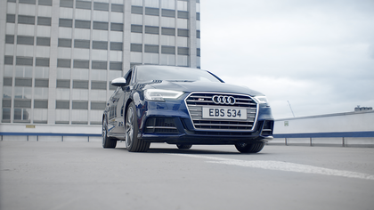 A blue Audi S3 from the front.