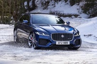 Jaguar XF driving in snow