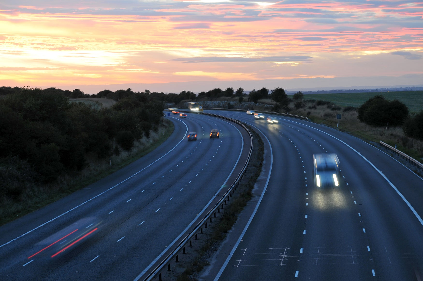 Curving motorway sunset