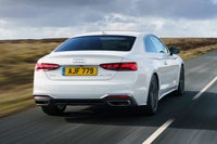 2020 Audi A5 driving rear-three quarter