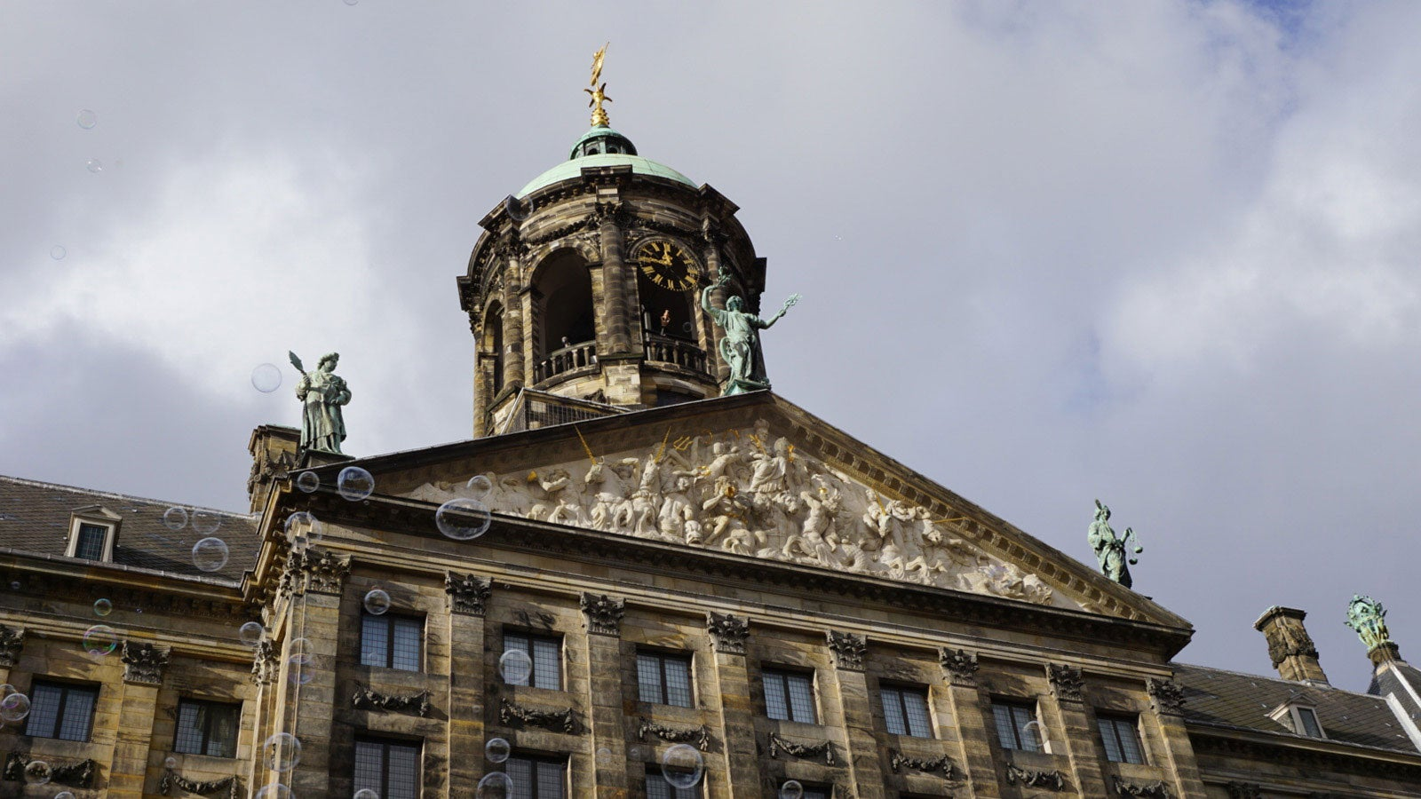 Close up of The Stadhuis Amsterdam showing statues on the roof