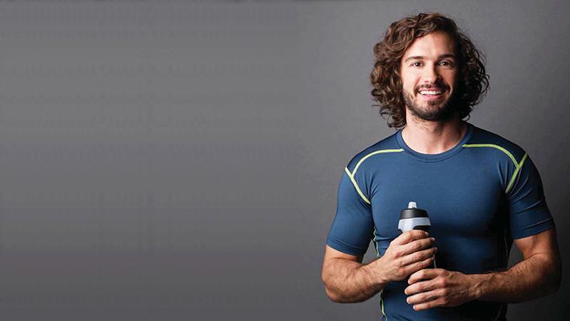 Joe Wicks holding a sports bottle