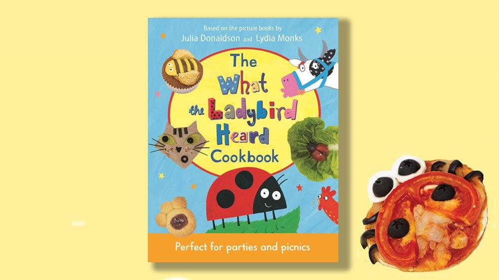 A picture of The What the Ladybird Heard Cookbook next to a ladybird pizza