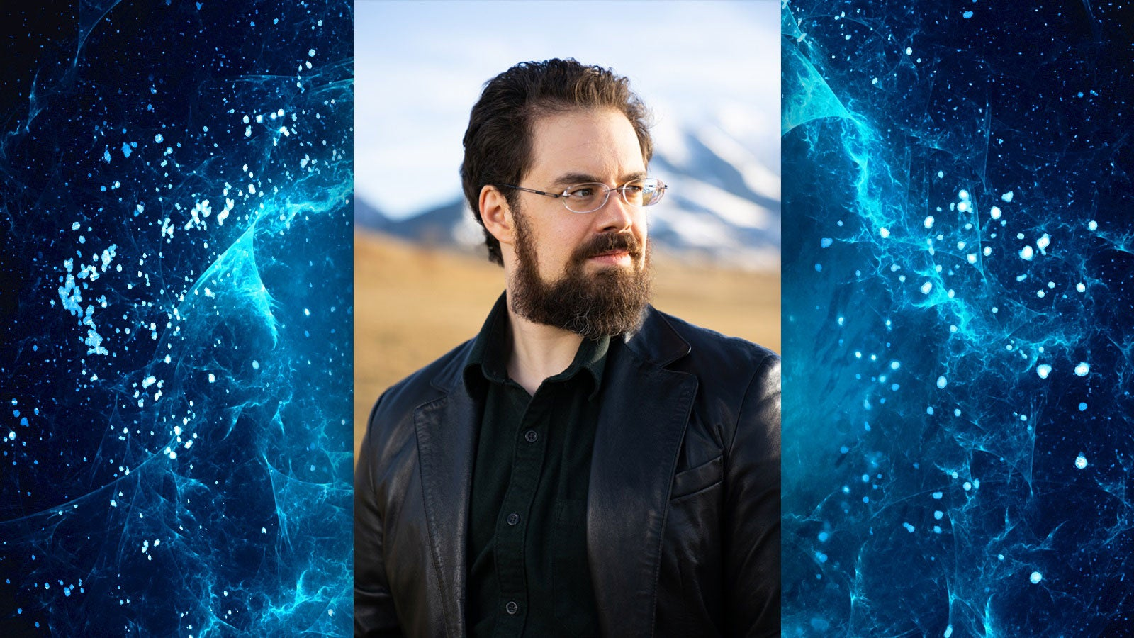 Photo of Christopher Paolini against a blue space background