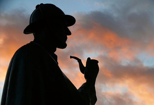 Sherlock Holmes silhouette with sunset