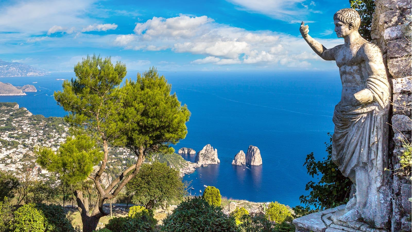 A statue overlooking the ocean in Italy.