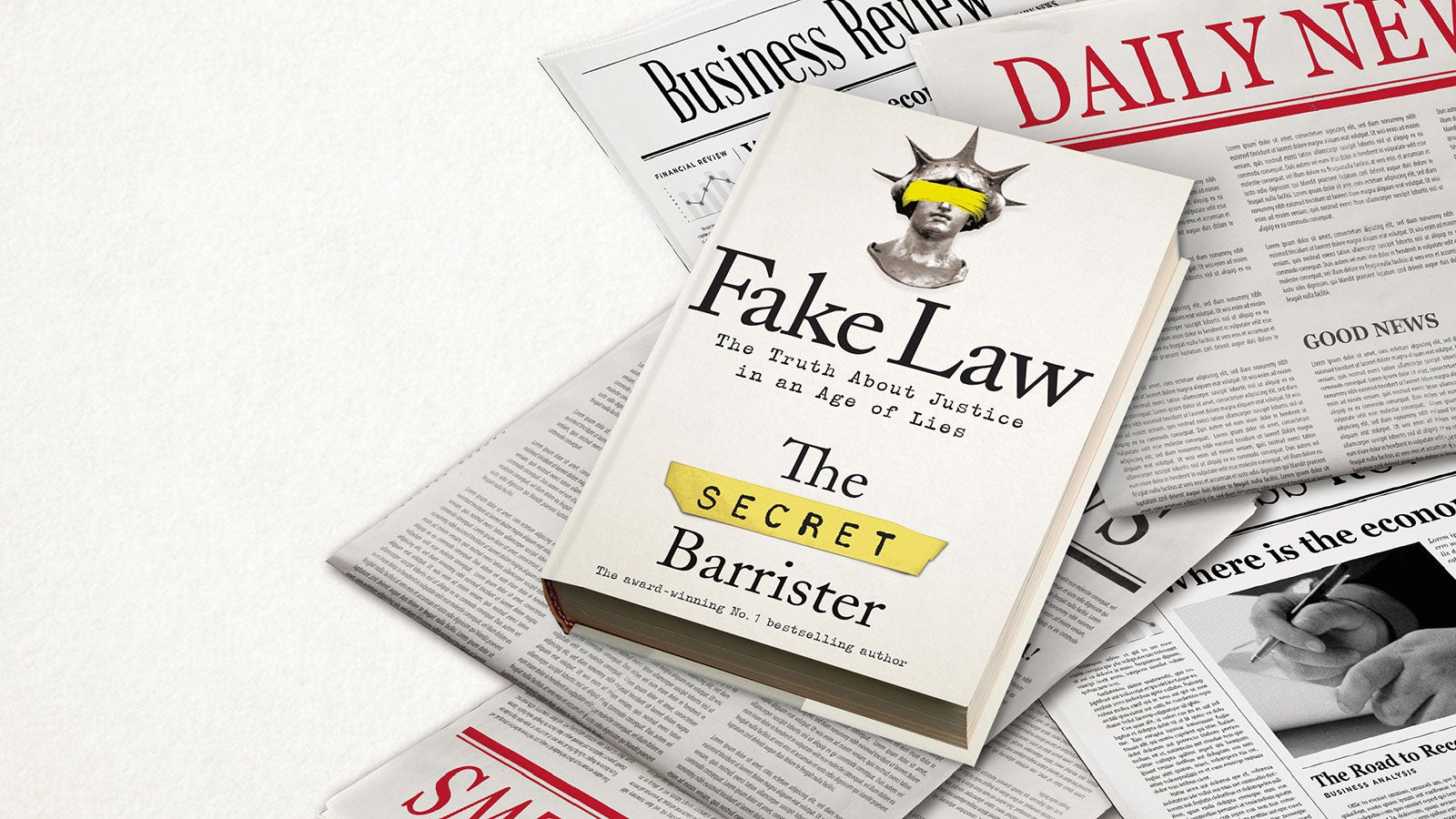 Fake Law book laying on a pile of newspapers