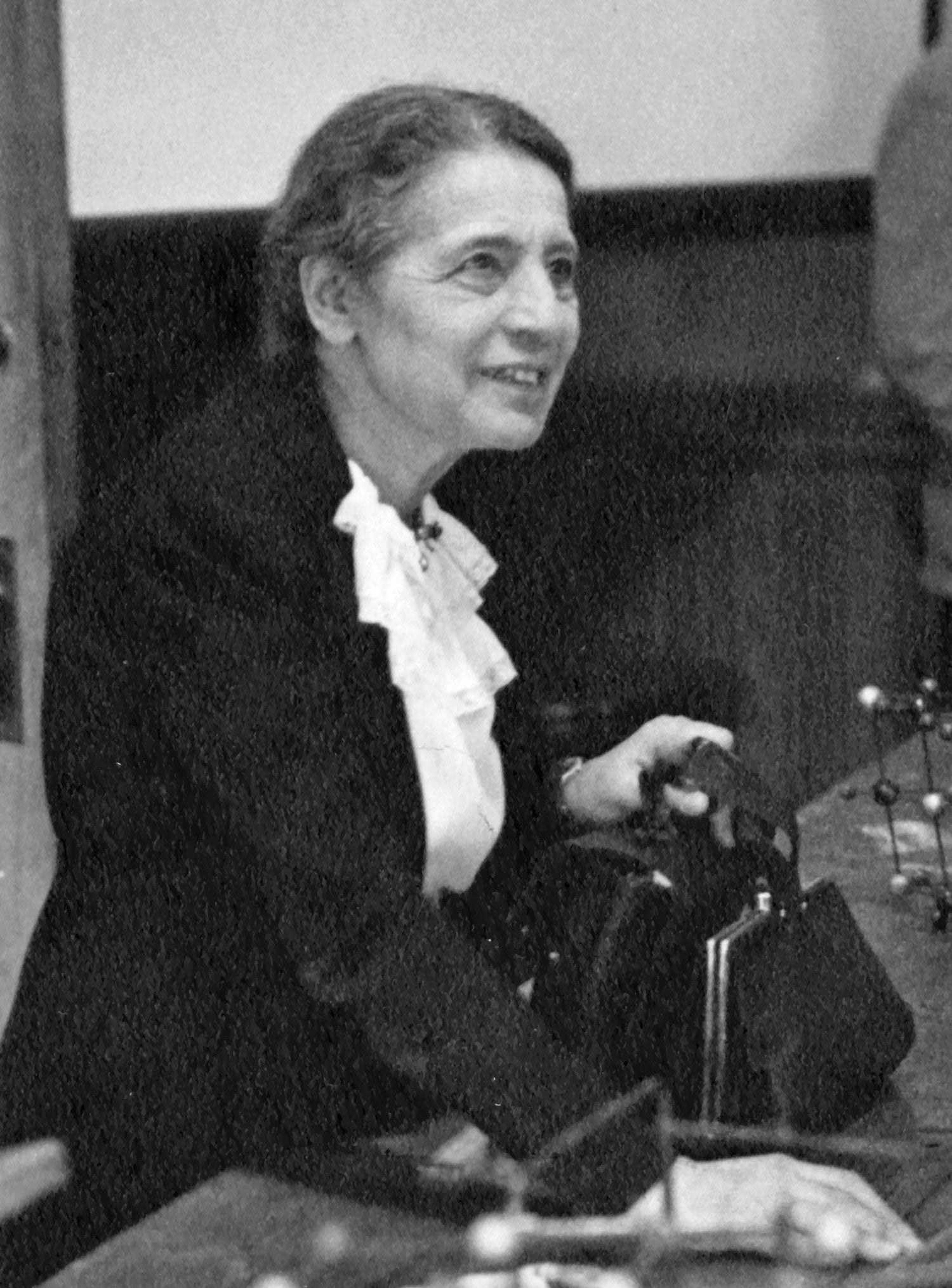 Black and white photograph of Lise Meitner lecturing at Catholic University in Washington D.C. in 1946