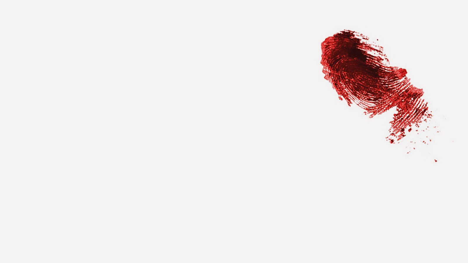 A thumbprint in blood on a plain white background