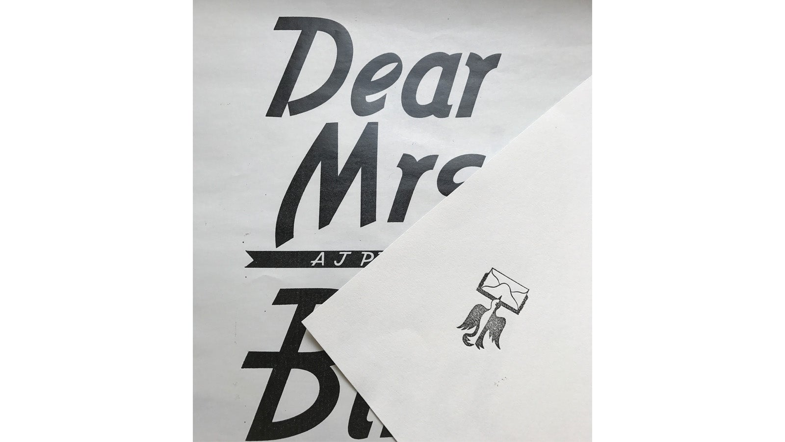 The typography of Dear Mrs Bird is sketched on an envelope design.