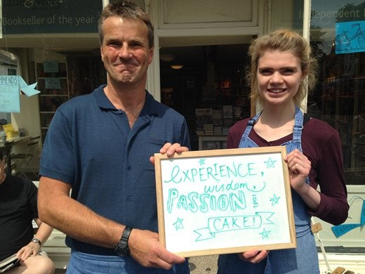 Jaffe and Neale at Chipping Norton Bookshop holding whiteboard