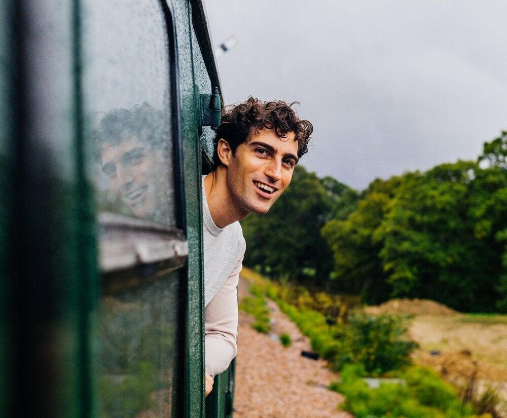 Author Sam Sedgman pokes his head from a train window