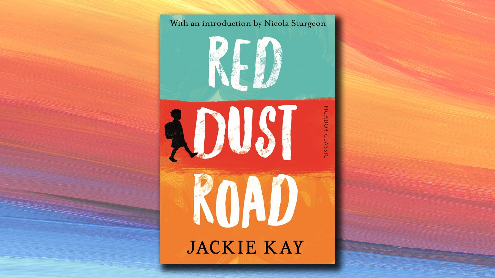 Red Dust Road jacket on a colourful background.