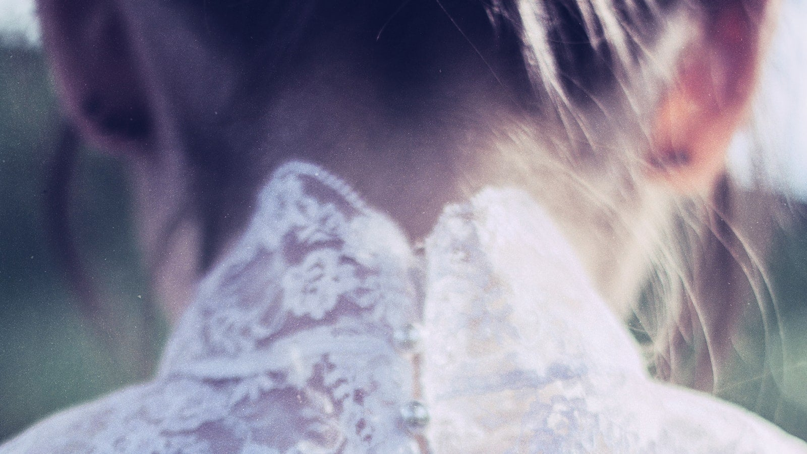 Image of the back of a woman's head in white dress, from the cover of The Woman in White