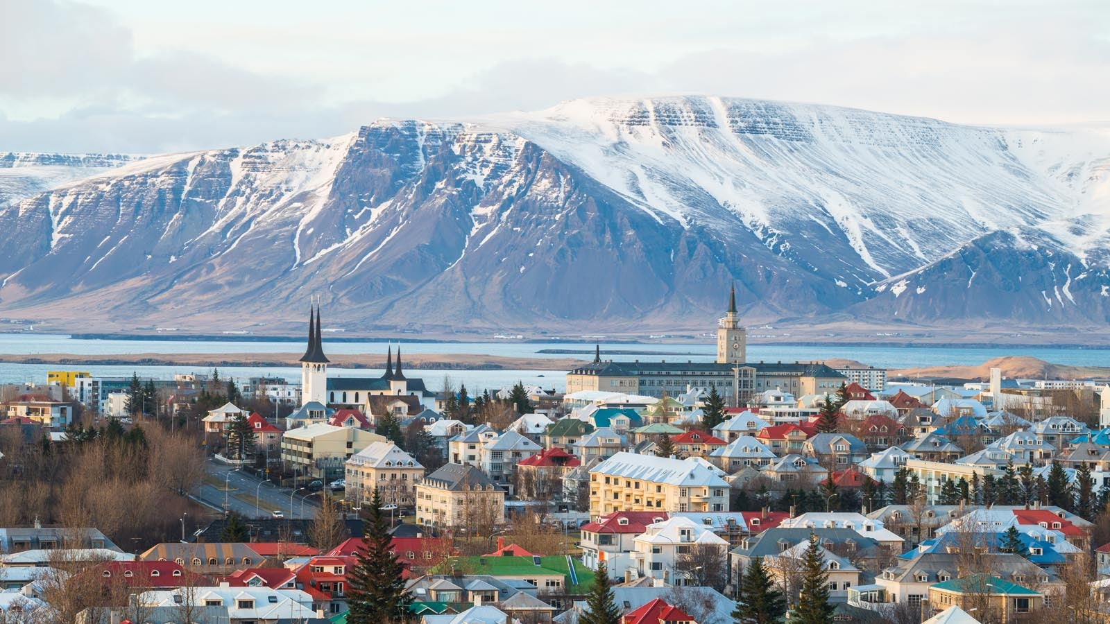 Nordic landscape showing town and snowy mountains