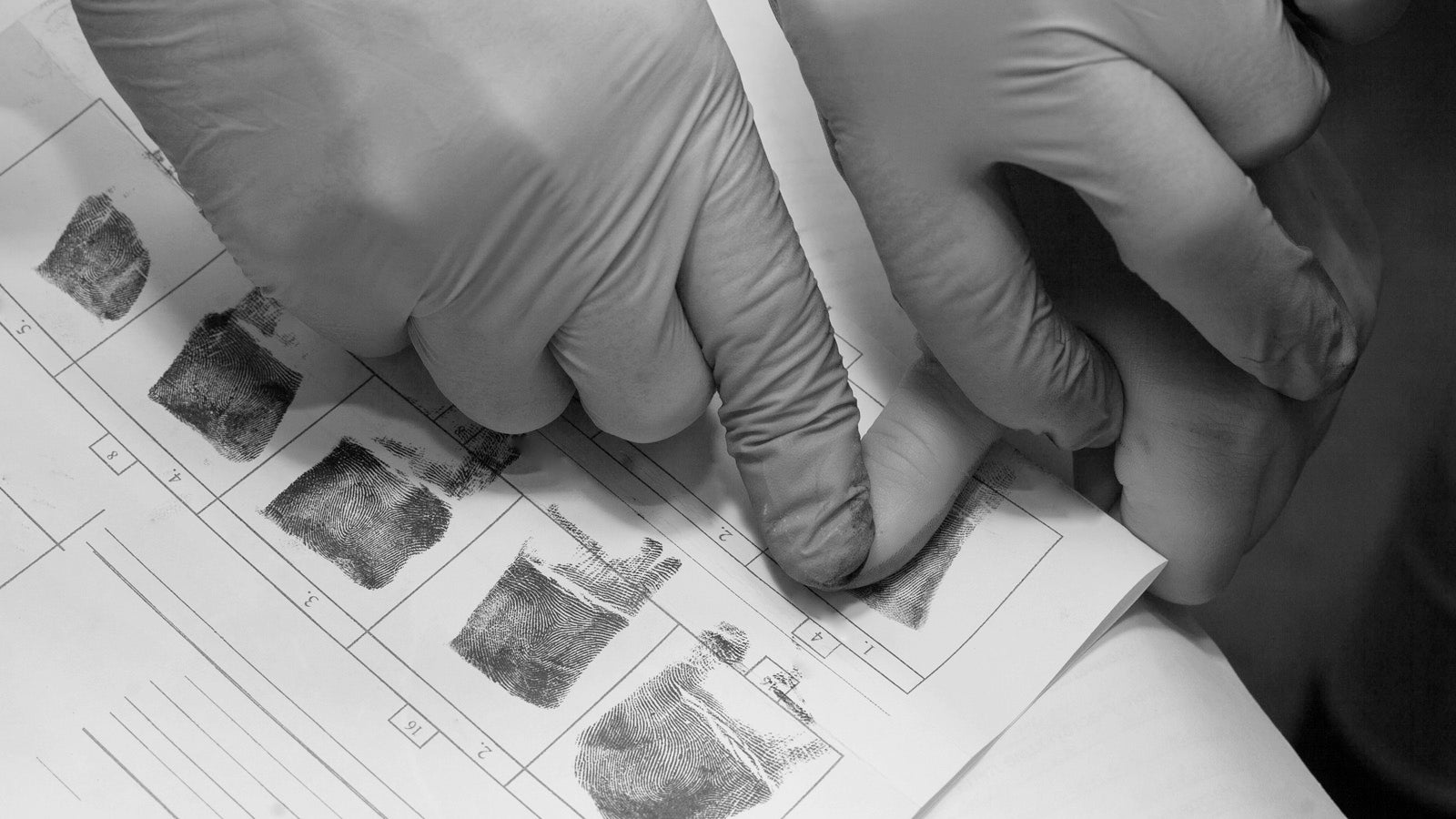 Black and white photo of ink fingerprints being taken