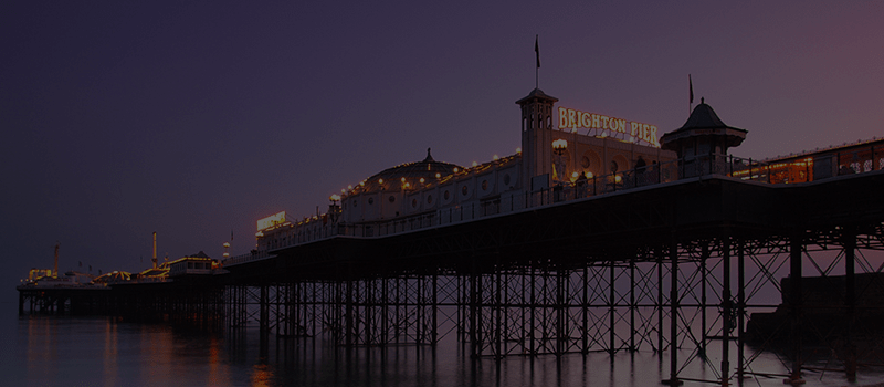 Brighton Pier lit up at dusk