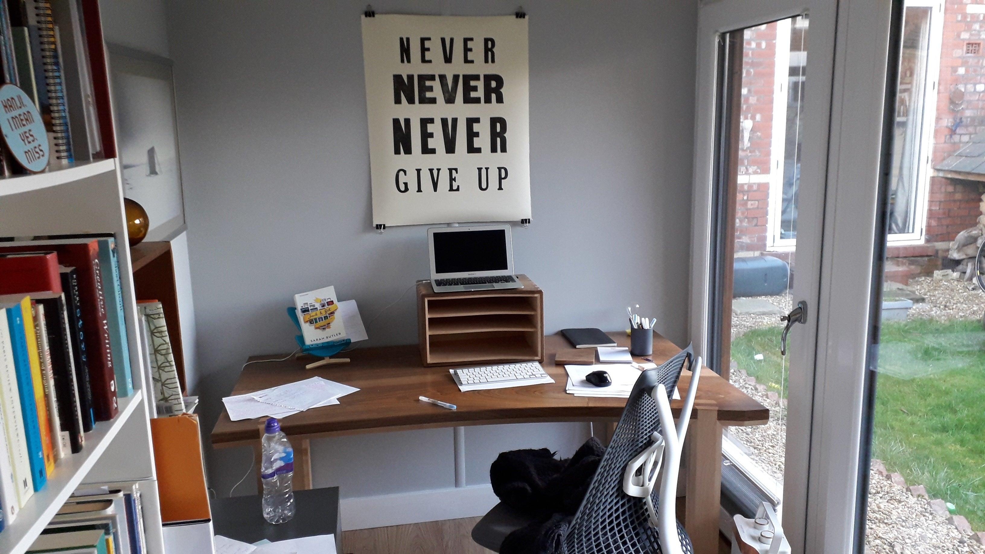 Sarah Butler's writing desk inside her garden studio