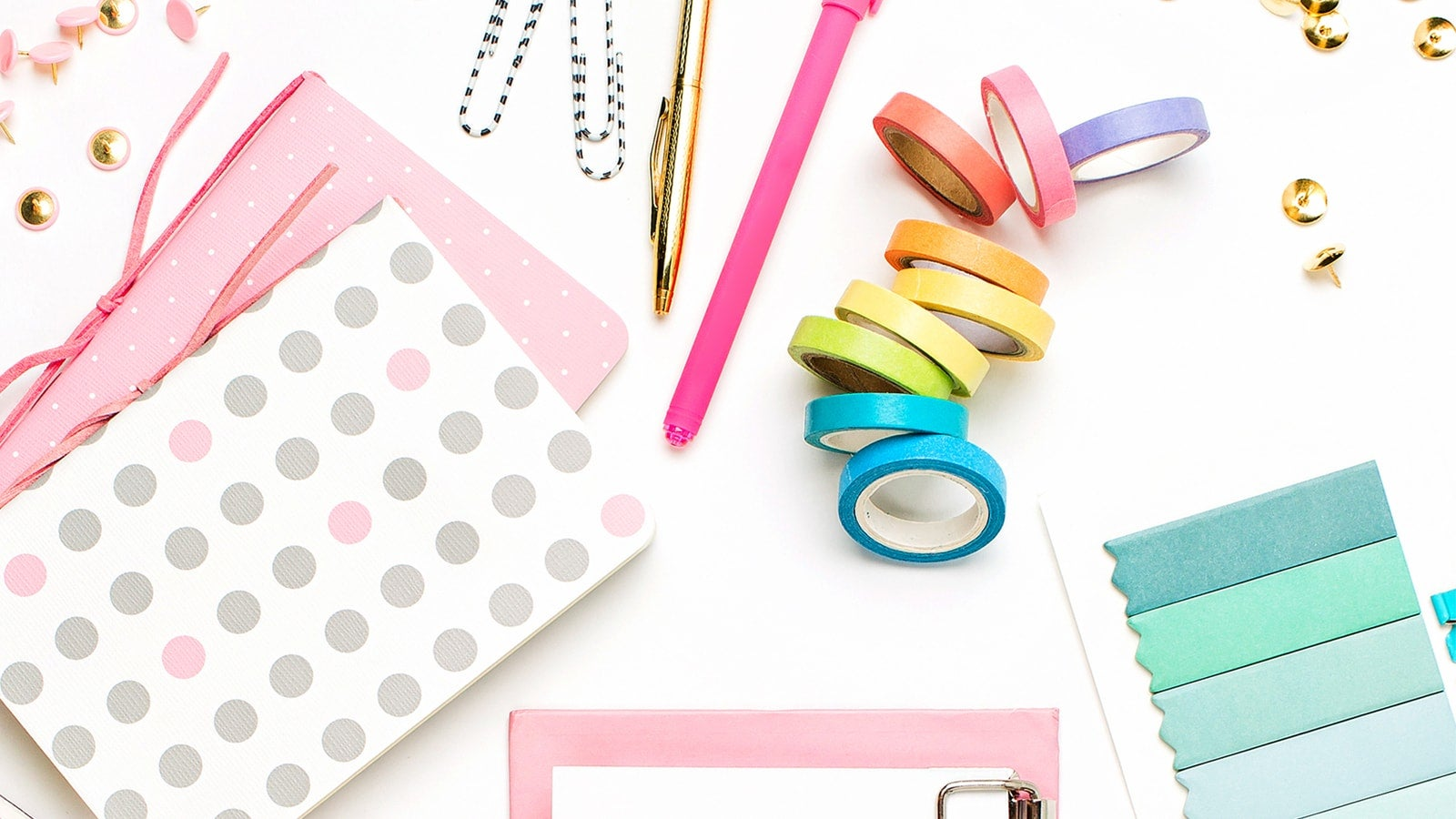 Colourful washi tape and stationery on a white surface