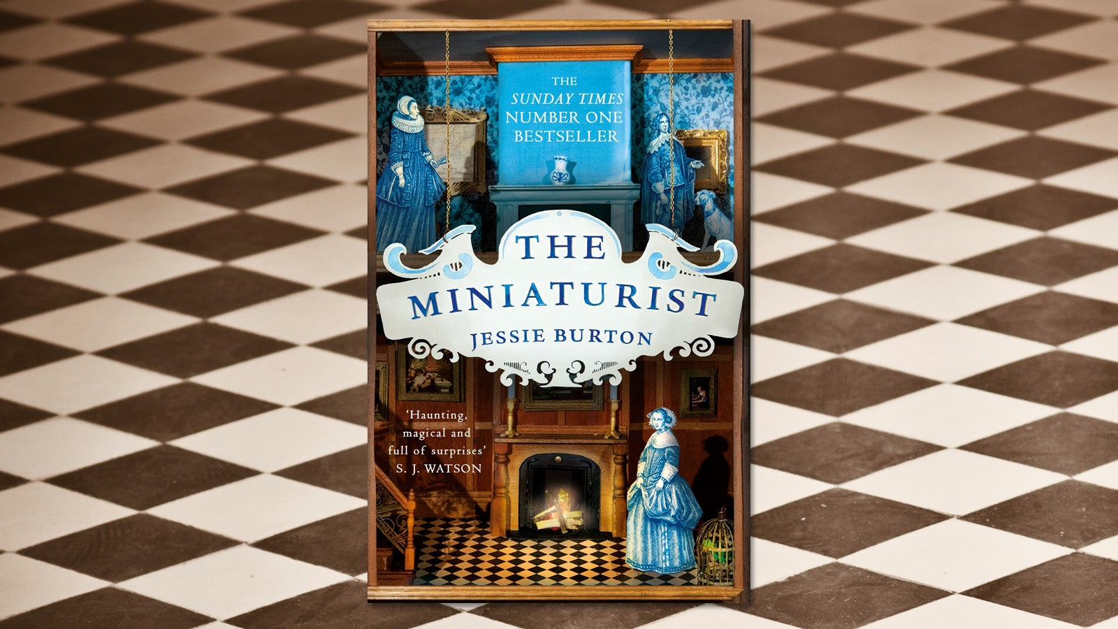The book cover for The Miniaturist against a tiled floor background