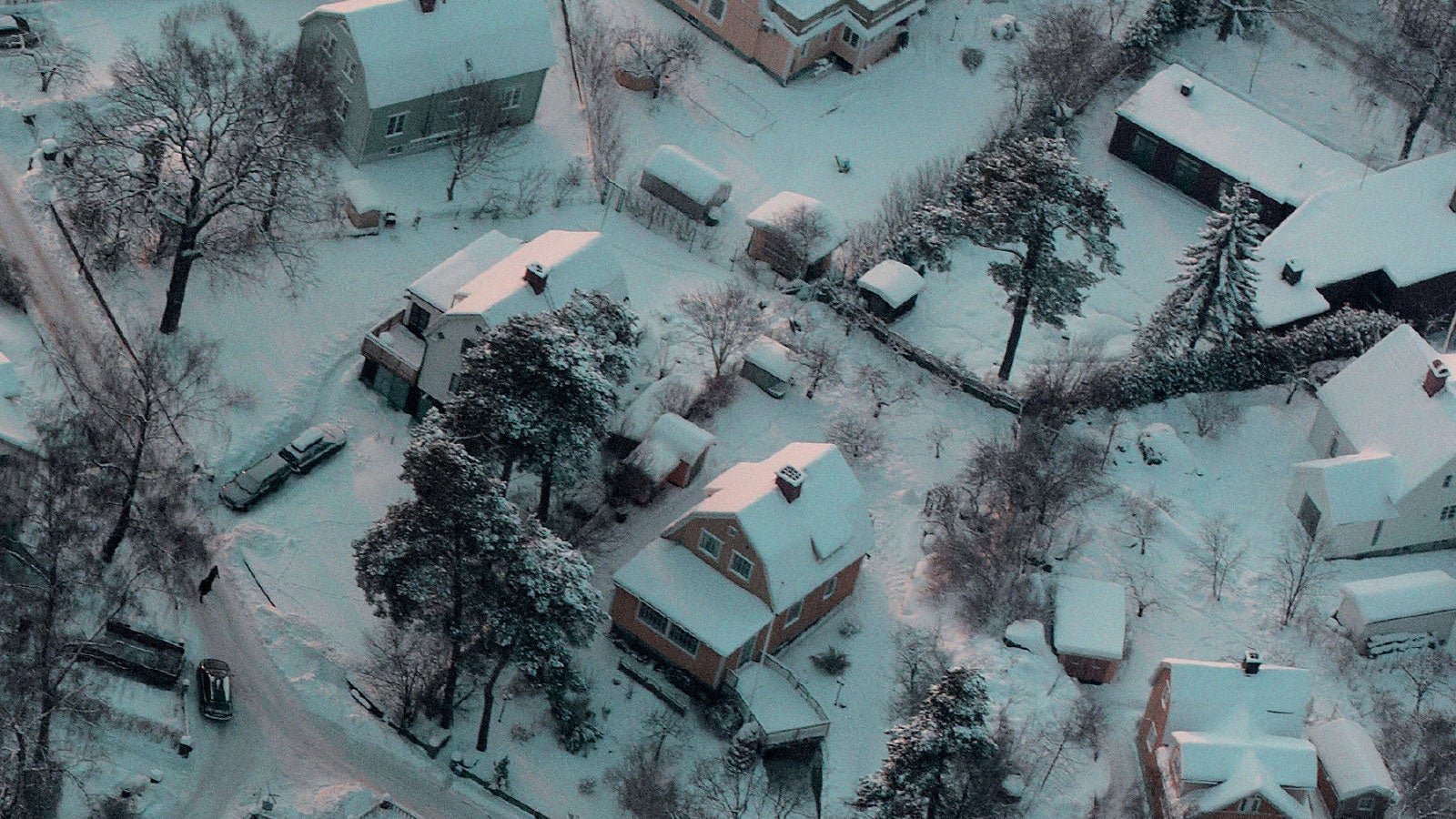 Aerial photograph of an American town covered in snow.
