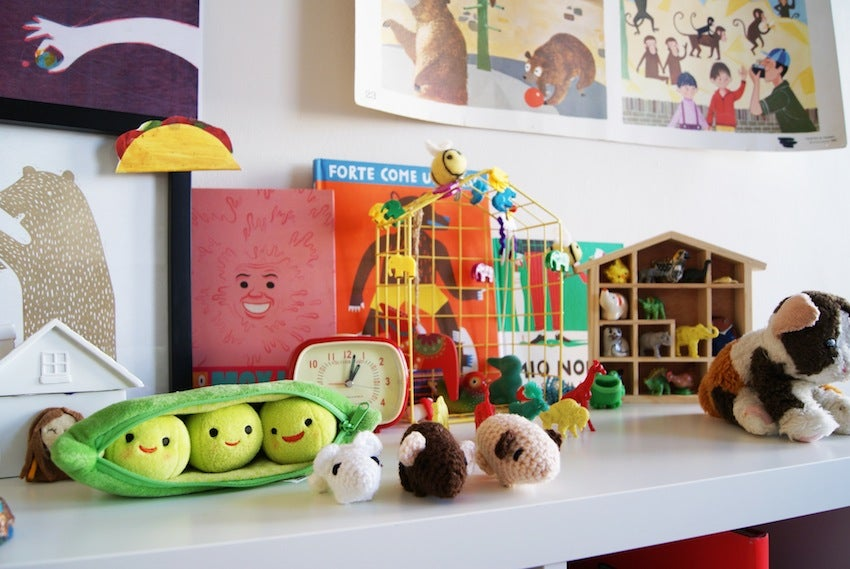 artist's collection of toys and books