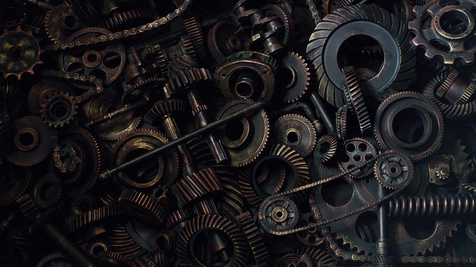 Close up image of cogs and mechanical chains
