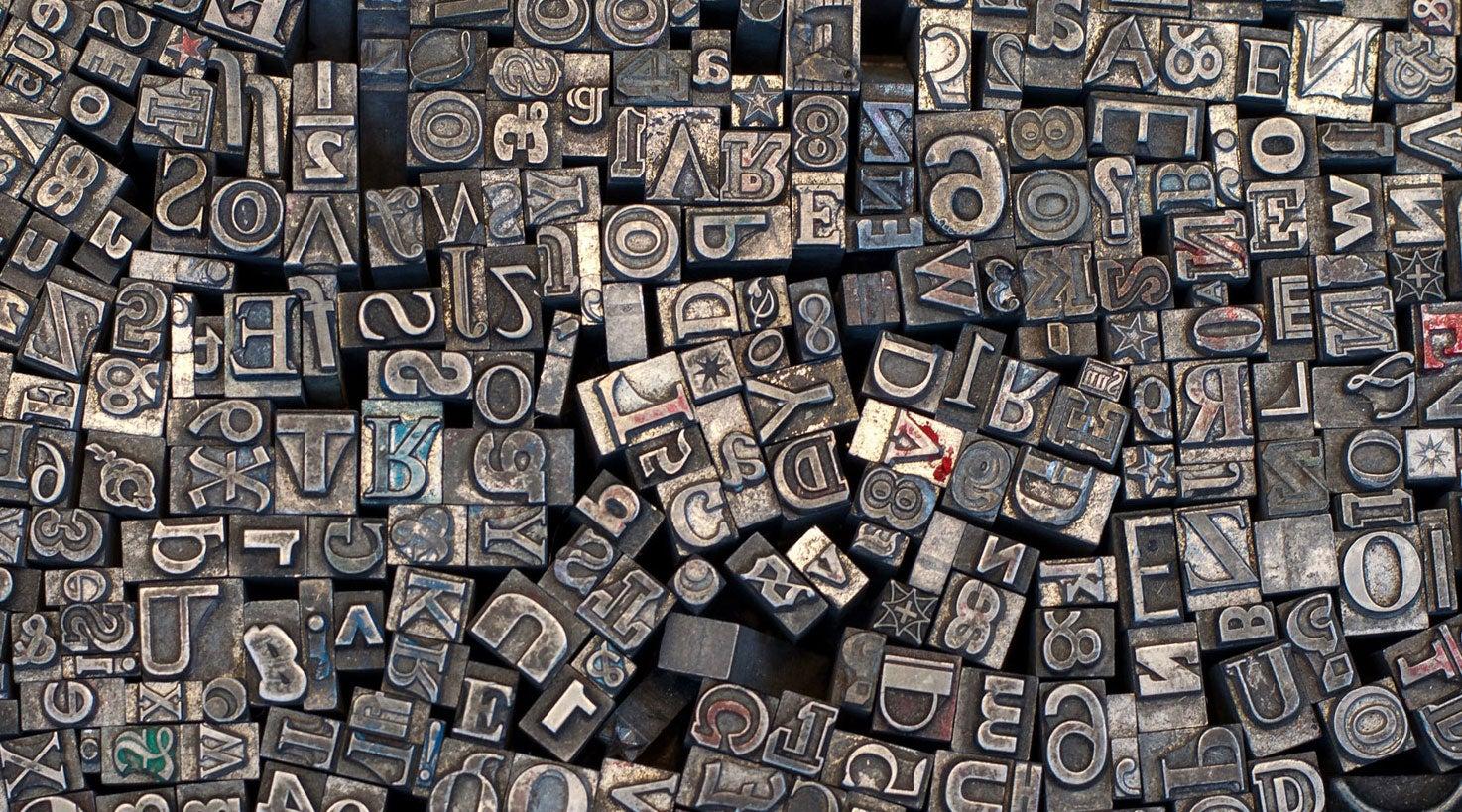Typewriter keys scattered.