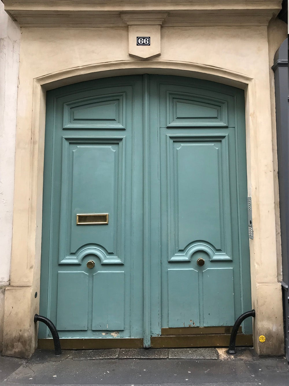 A doorway painted green