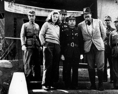 Martha Gellhorn and Ernest Hemingway with unidentified Chinese military officers, Chungking, China, 1941